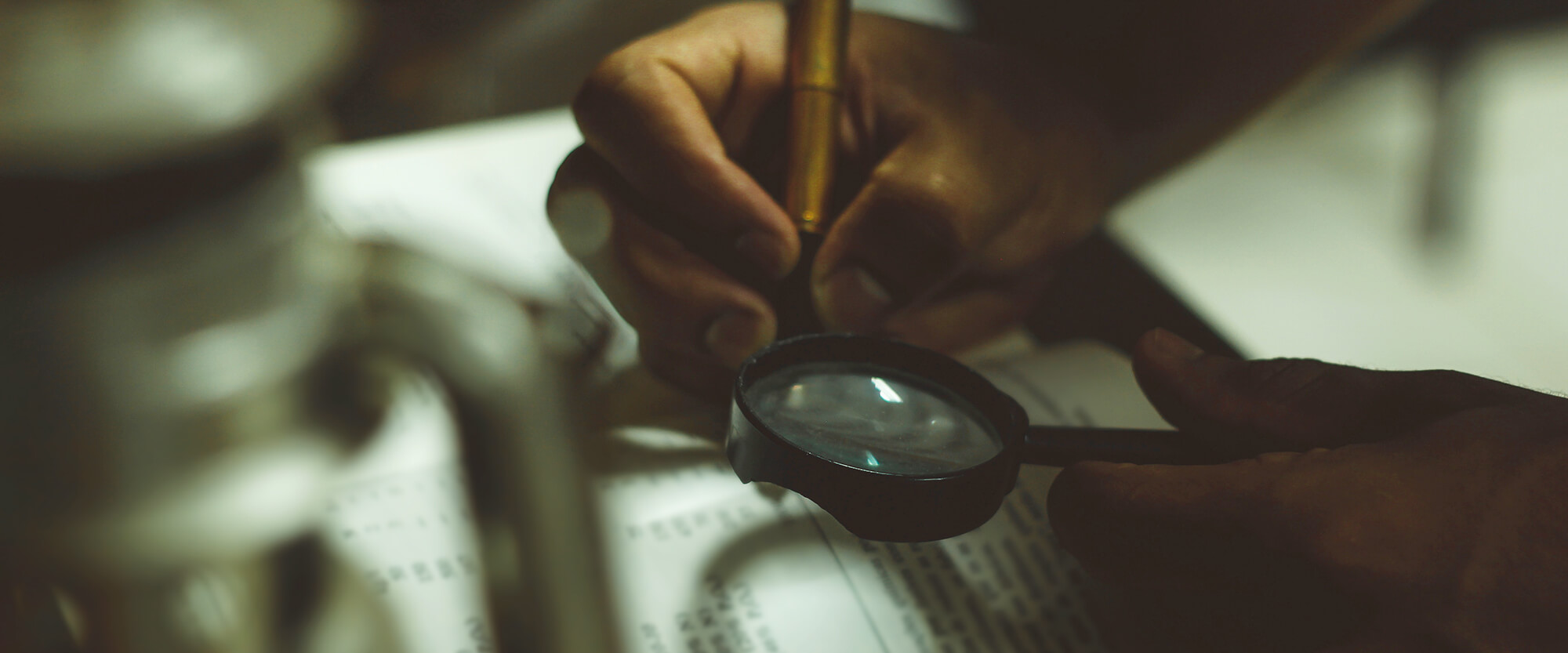 Magnifying glass on bible