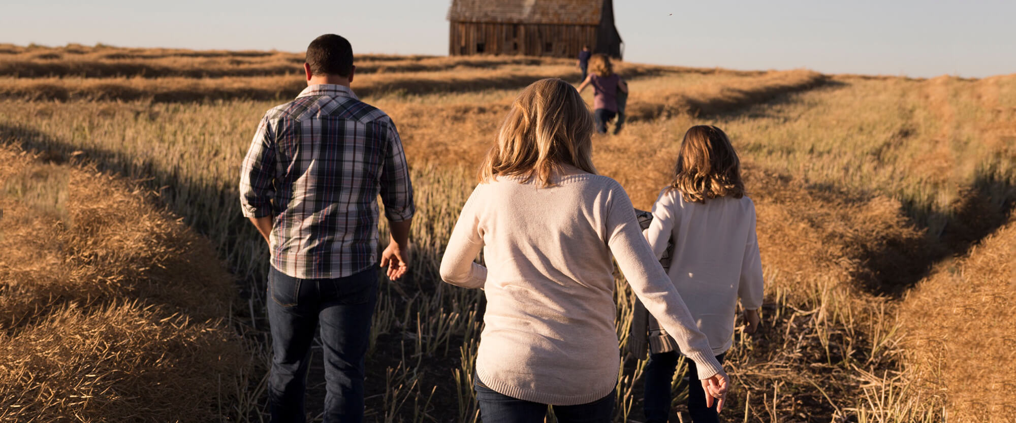 Family walking in a field